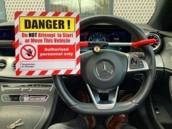 Steering Wheel Lockout with integral Warning Sign